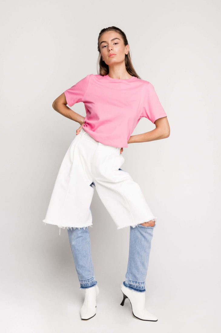 Sustainable fashion label Ksenia Schnaider's Reworked Denim Cutoff Jeans, AKA 'Demi-Denims', are a street style favourite and have a cult following. The two toned jeans are made from secondhand denim, reworked to make a pair of jeans that feature a cut-out at the knee.